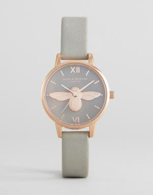 Olivia Burton Розово-золотистые часы с серым кожаным ремешком и пчелой. Цвет: серый