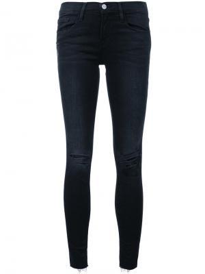 Рваные джинсы кроя скинни Frame Denim. Цвет: чёрный