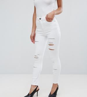 ASOS Petite Зауженные рваные джинсы с завышенной талией RIDLEY. Цвет: белый