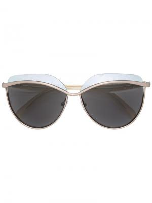 Солнцезащитные очки в металлической оправе Emilio Pucci. Цвет: телесный