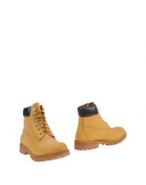 Полусапоги и высокие ботинки PIUMI. Цвет: охра