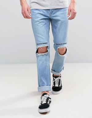 Kubban Узкие джинсы с отворотом и рваной отделкой на коленях. Цвет: синий