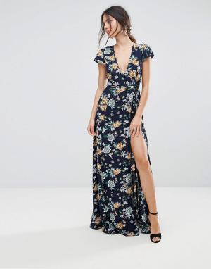 Uttam Boutique Платье макси с запахом и цветочным принтом. Цвет: темно-синий