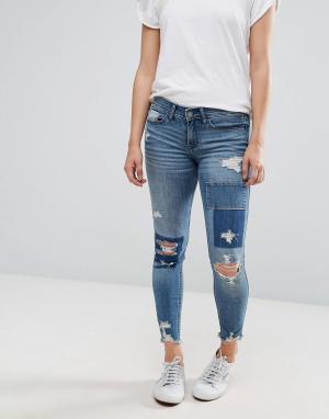 Hollister Укороченные рваные джинсы. Цвет: синий