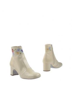 Полусапоги и высокие ботинки RAYNE. Цвет: светло-желтый