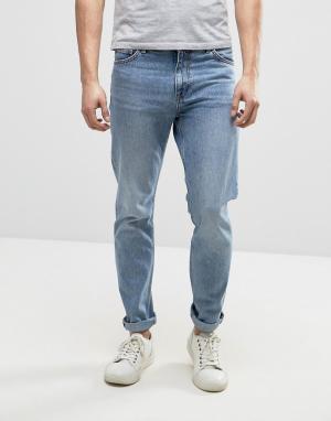 Weekday Суженные книзу синие выбеленные джинсы Sunday. Цвет: синий