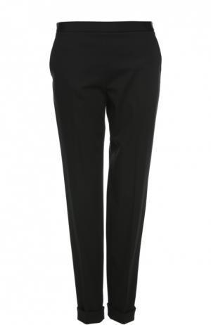 Зауженные брюки с отворотами и боковыми карманами The Row. Цвет: черный