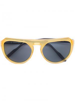Солнцезащитные очки в круглой оправе Courrèges. Цвет: жёлтый и оранжевый