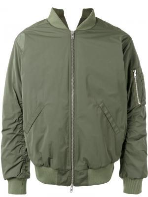 Куртка-бомбер  с карманом на молнии Martine Rose. Цвет: зелёный