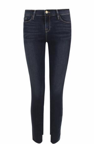 Укороченные джинсы-скинни с потертостями Frame Denim. Цвет: синий
