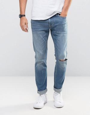 Hollister Голубые выбеленные зауженные джинсы стретч. Цвет: синий