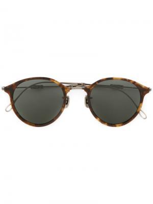 Солнцезащитные очки в округлой оправе Eyevan7285. Цвет: коричневый