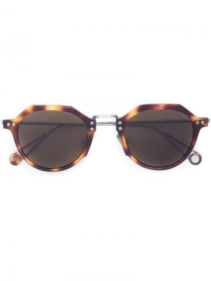 Солнцезащитные очки в круглой оправе Ahlem. Цвет: коричневый