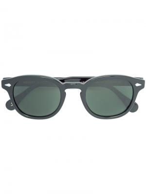 Солнцезащитные очки в круглой оправе Moscot. Цвет: чёрный