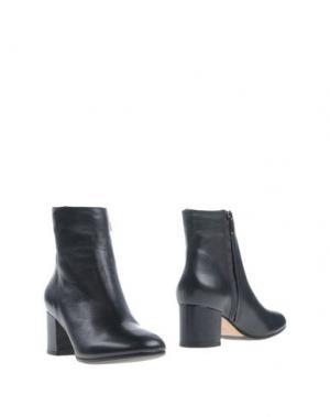 Полусапоги и высокие ботинки THE SELLER. Цвет: темно-синий