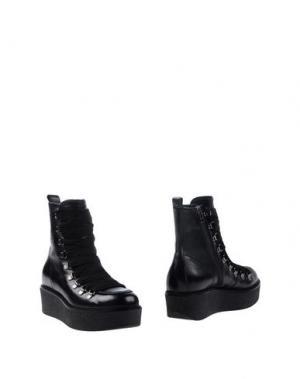 Полусапоги и высокие ботинки JANET SPORT. Цвет: черный