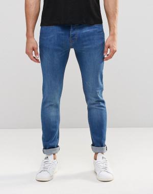 LDN DNM Супероблегающие состаренные джинсы. Цвет: синий