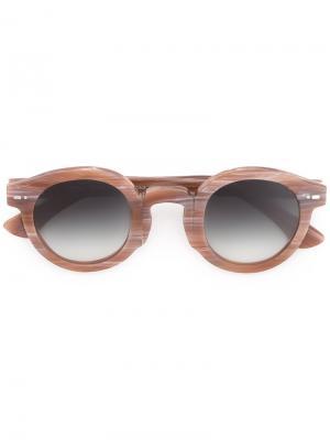 Солнцезащитные очки в круглой оправе Movitra. Цвет: коричневый