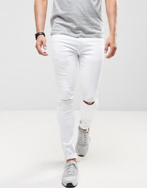 Ringspun Супероблегающие джинсы с рваными коленями. Цвет: белый