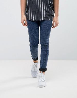 ASOS Темно-синие суперзауженные джинсы с эффектом кислотной стирки. Цвет: синий