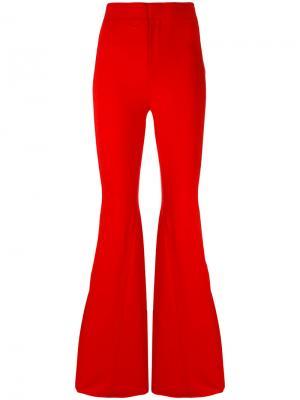 Расклешенные брюки Givenchy. Цвет: красный