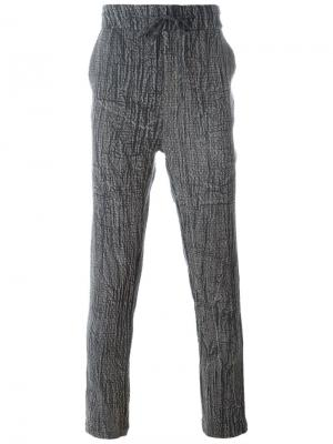 Спортивные брюки с эффектом змеиной кожи Tony Cohen. Цвет: чёрный