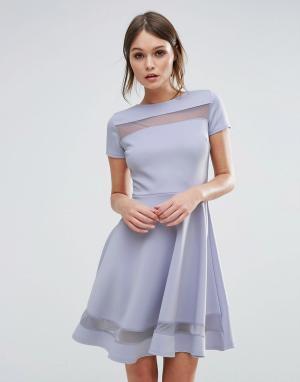 Club L Короткое приталенное платье с сетчатыми вставками. Цвет: синий