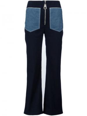 Саржевые расклешенные брюки Edun. Цвет: синий