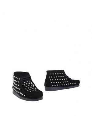 Полусапоги и высокие ботинки GIENCHI. Цвет: черный