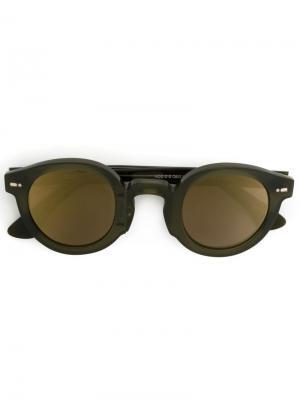 Солнцезащитные очки в круглой оправе Movitra. Цвет: зелёный