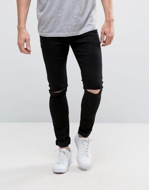 ASOS Черные джинсы с напылением и рваными коленями. Цвет: черный