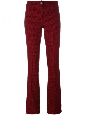 Расклешенные брюки в ломанную клетку Ultràchic. Цвет: красный