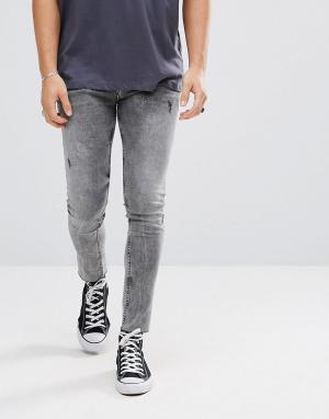 ASOS Черные укороченные джинсы скинни с эффектом кислотной стирки. Цвет: черный