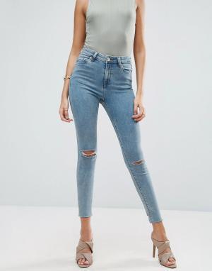 ASOS Выбеленные голубые джинсы скинни с асимметричным краем RIDLEY. Цвет: синий