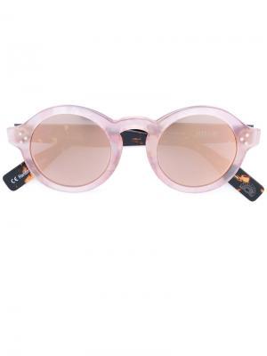 Солнцезащитные очки в круглой оправе Zanzan. Цвет: телесный