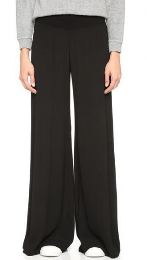 Широкие брюки из крепа Enza Costa. Цвет: голубой
