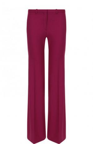 Однотонные расклешенные брюки из шерсти Theory. Цвет: розовый