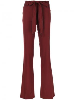 Расклешенные брюки с поясом Victoria Beckham. Цвет: красный