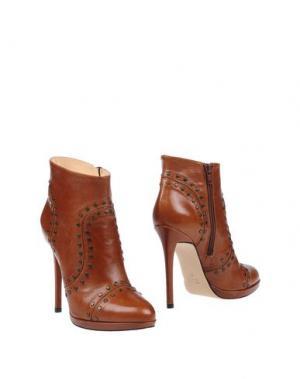 Полусапоги и высокие ботинки CHIARINI BOLOGNA. Цвет: коричневый