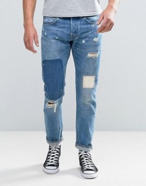Edwin Суженные книзу джинсы классического кроя с рваной отделкой и заплаткам. Цвет: синий