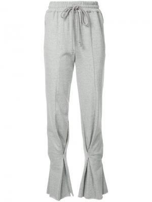 Спортивные брюки клеш Irene. Цвет: серый