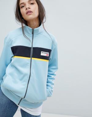 New Balance Синяя спортивная куртка. Цвет: синий