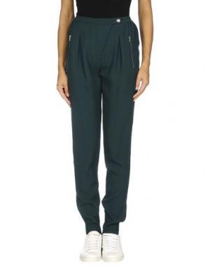 Повседневные брюки SANDRO Paris. Цвет: зеленый
