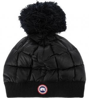 Утепленная шапка с пуховым наполнителем Canada Goose. Цвет: черный
