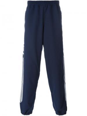 Спортивные брюки Adidas Originals X Palace. Цвет: синий