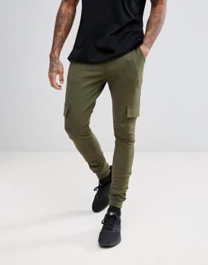 Troy Джоггеры с боковыми карманами. Цвет: зеленый