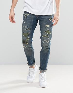 ASOS Синие зауженные джинсы с рваной отделкой и камуфляжным принтом на запл. Цвет: синий