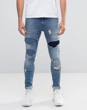 ASOS Супероблегающие джинсы с рваной отделкой. Цвет: синий