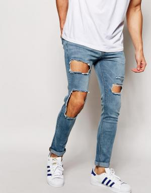 ASOS Супероблегающие джинсы с большими дырками. Цвет: синий