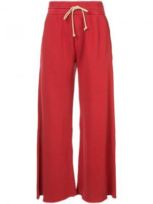 Расклешенные спортивные брюки Mother. Цвет: красный